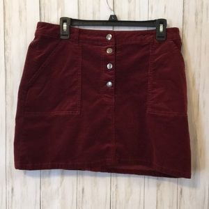 Red corduroy mini skirt with pockets